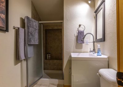 Full bathroom with shower inside the Brewery Abode air B&B.