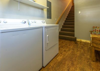 Washer and dryer at the bottom of stairs in the Brewery abode.