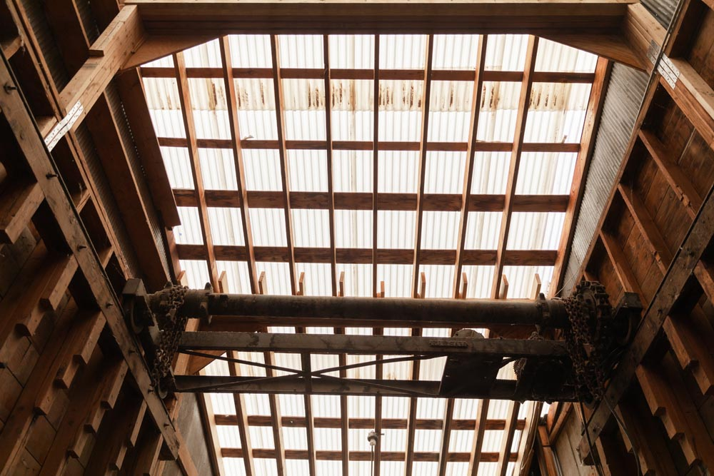 Ceiling view of 2x4 and chains in the Historic Hayden Granary.