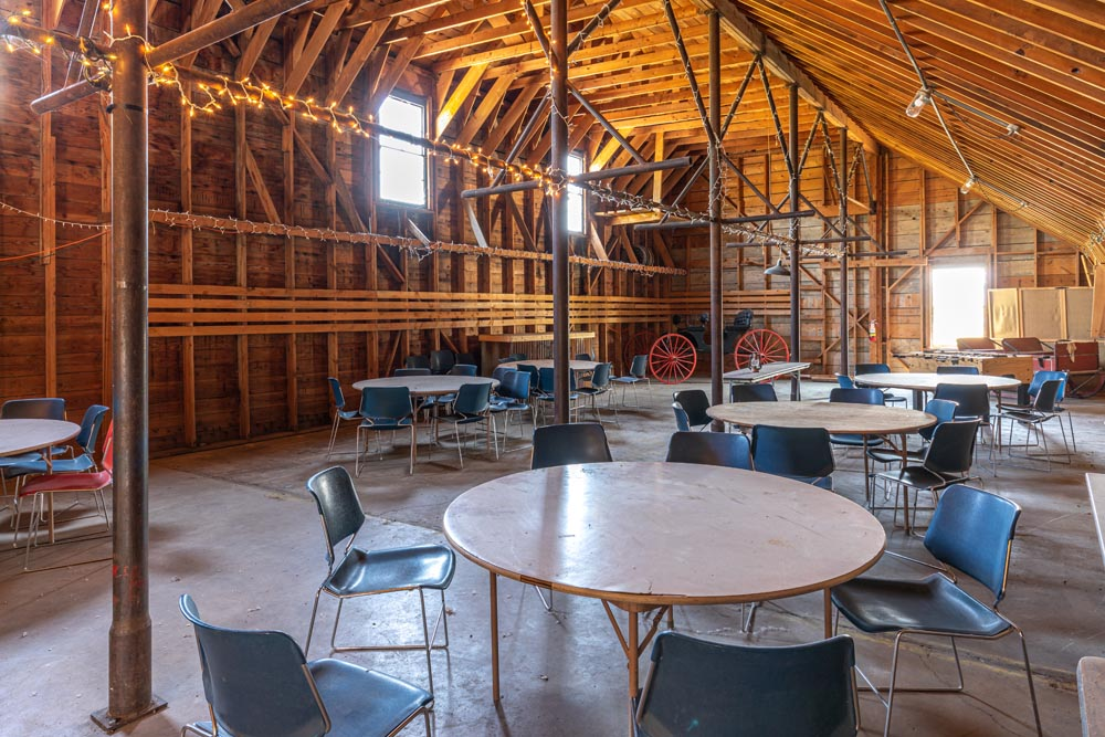 Tables and chairs set up inside the indoor dance hall at the historic Hayden Granary.