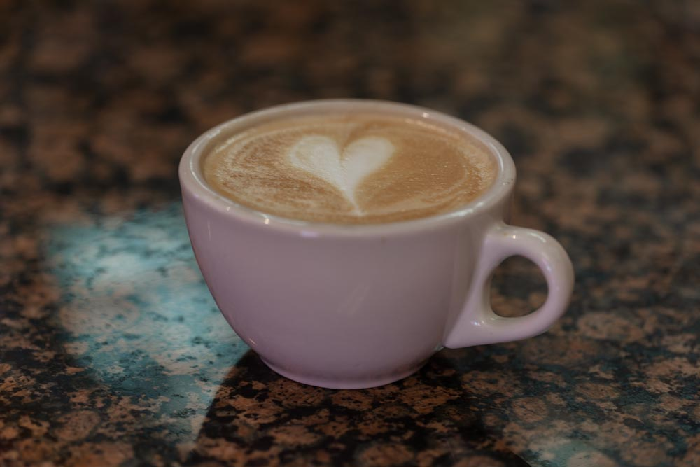 Detail shot of latte with a heart shape in the foam