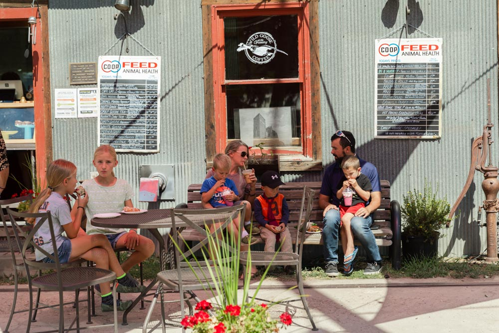 Family with kids enjoying food on a nice day at Wild Goose Coffee at the Historic Hayden Granary