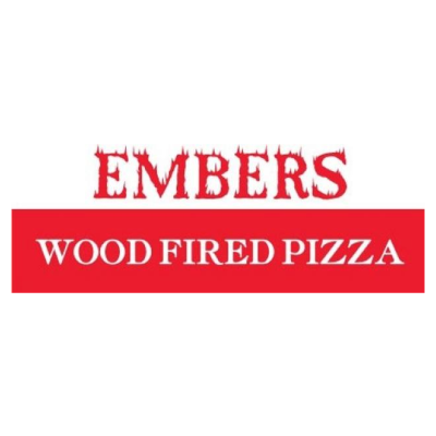 Glowing woodfired Pizza oven cooking pizza at Ember inside the Hayden Granary.