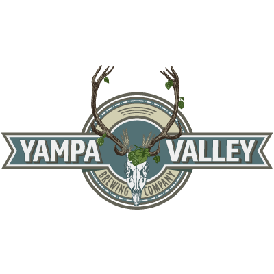 Yampa Valley Brewing lit up at night time with patrols on the patio.
